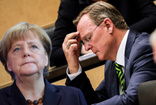 Almanya'da eyalet başbakanı koronavirüs toplantısında oyun oynarken yakalandı