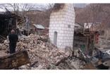 Oltu'da Miraç Gecesi çıkan yangında yanan caminin enkazı kaldırılıyor