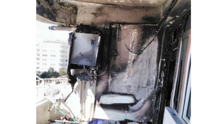 Adıyaman'da balkonda bulunan kombi yanmaya başladı, evde maddi hasara neden oldu